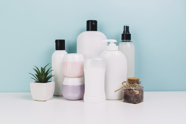 cosmetics-jars-bottles-near-plant