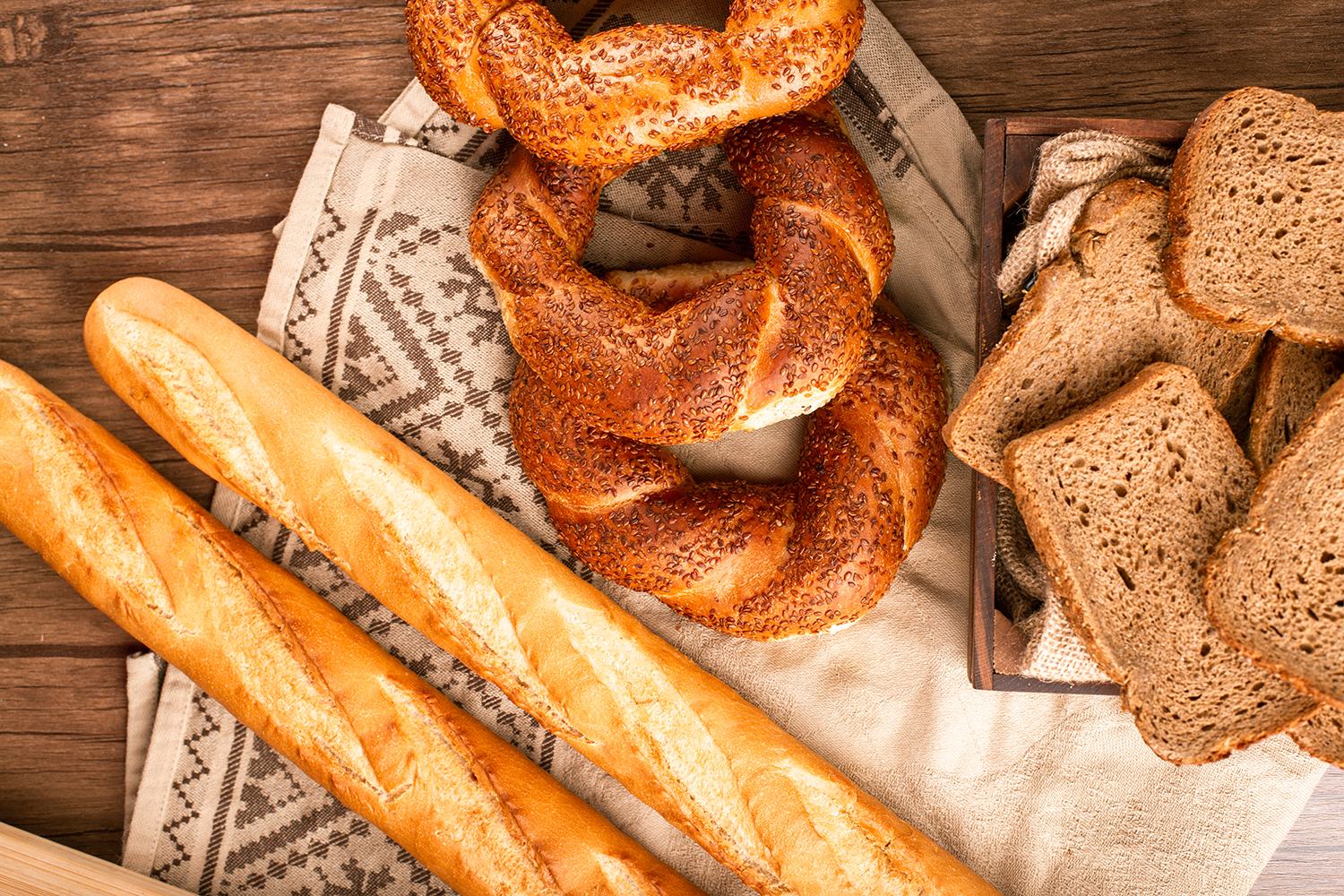 French baguette with turkish bagels and slices of bread in box